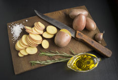 Sliced raw potatoes. On a cutting board - cooking Royalty Free Stock Photo