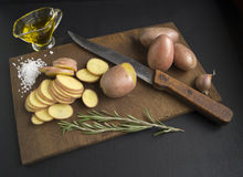 Sliced raw potatoes. On a cutting board - cooking Stock Photography