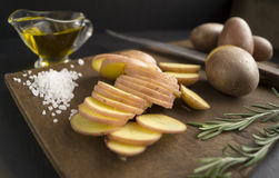 Sliced raw potatoes. On a cutting board - cooking Royalty Free Stock Image