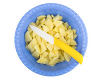 Sliced raw potatoes and knife in plastic bowl Stock Photography