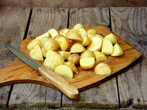 Sliced raw potatoes and knife Stock Photo