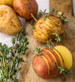 Sliced raw potatoes with sprigs of thyme, sea salt Stock Image