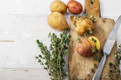 Sliced raw potatoes with sprigs of thyme, sea salt Royalty Free Stock Photography