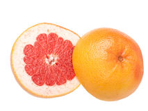 Sliced raw red grapefruit on white Royalty Free Stock Photography