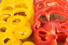 Sliced Raw Red and Yellow Bell Peppers Stock Photography