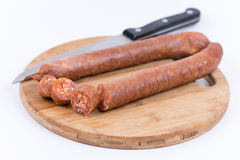 Sliced raw sausage on the cutting board Stock Image