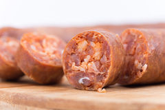 Sliced raw sausage on the cutting board Stock Photo