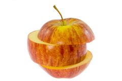Sliced red apple. Red apple sliced horizontally isolated on white background Royalty Free Stock Image