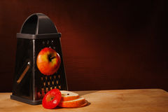 Sliced red apple on grater Royalty Free Stock Photo