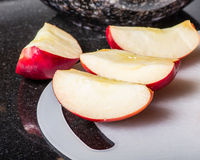 Sliced red apples on cutting board Stock Image
