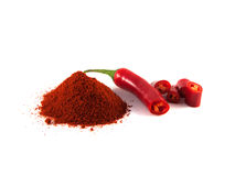 Sliced red chili hot pepper with hill of paprika Royalty Free Stock Images