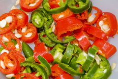 Sliced red and green chillies. Red and green chillies sliced in a bowl Royalty Free Stock Photography