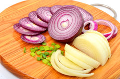 Sliced red and green onion on the cutting board isolated on whit Stock Photography