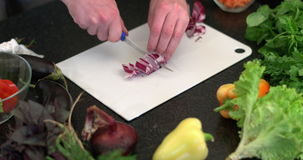 Sliced red onion in kitchen stock video footage