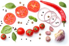 sliced red onion, red hot chili pepper, tomato, garlic and spices isolated on white background. top view stock image