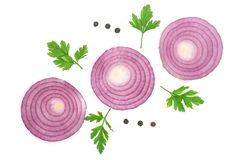 Sliced red onion rings with parsley leaves and peppercorns isolated on white background. Top view.  Royalty Free Stock Image