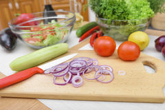 Sliced red onion rings salad. Stock Photos