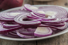 Sliced red onion on white plate Stock Photo
