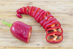 Sliced red pepper. Sliced red ripe fresh pepper on cutting board Royalty Free Stock Photography