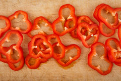 Sliced red peppers on cutting board Stock Photos