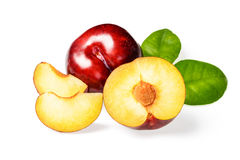 Sliced red plum. On the white background Stock Photography