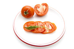 Sliced red Tomatoes with Dill Royalty Free Stock Image