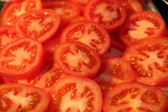 Sliced Red Tomatoes. Sliced fresh Red Tomatoes Royalty Free Stock Image