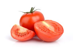 Sliced red tomatoes  on white. Sliced red delicious tomatoes  on white Stock Photos