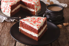 Sliced red velvet cake and coffee with milk on the table. Horizo Stock Photo