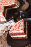Sliced red velvet cake and coffee with milk on the table. vertic Royalty Free Stock Image