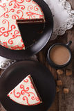 Sliced red velvet cake and coffee with milk on the table. vertic Stock Image