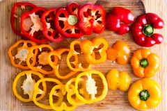 Sliced Red and Yellow Bell Peppers on Wooden Board Stock Image