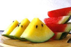 Sliced red and yellow watermelon fruit Stock Photography