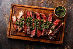 Sliced Ribeye steak with chimichurri sauce Royalty Free Stock Images