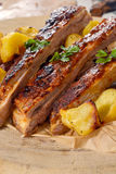 Sliced ribs and potatoes Royalty Free Stock Photography