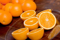Sliced ripe appetizing delicious orange on brown table Stock Photos
