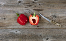 Sliced ripe bell pepper and paring knife. Sliced bell pepper and paring knife on rustic wood in flat lay format Stock Photography
