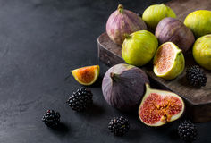 Sliced ripe figs. On a wooden table. Black background Stock Photos
