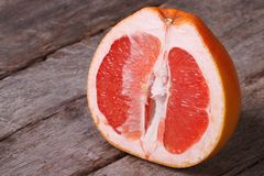 Sliced ripe grapefruit on an old wooden table Royalty Free Stock Image