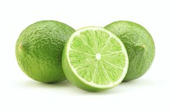 Ripe lime isolated. Sliced ripe green lime fruit isolated on white background stock image