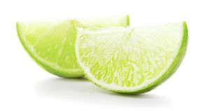 Ripe lime. Sliced ripe green lime fruit on white background royalty free stock image