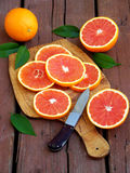 Sliced ripe Sicilian blood orange on an wooden cutting board. Stock Photography