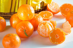 Sliced ripe tangerines , peeled, scattered Royalty Free Stock Image
