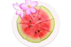 Sliced ripe watermelon fruit  on white background. Royalty Free Stock Images