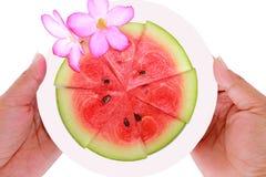 Sliced ripe watermelon fruit  on white background. Royalty Free Stock Photo
