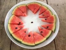 Sliced ripe watermelon place a sort of white plate around. Sliced ripe watermelon place a sort of white plate around, refreshing fruit Stock Photos