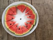 Sliced ripe watermelon place a sort of white plate around. Sliced ripe watermelon place a sort of white plate around, refreshing fruit Stock Photo