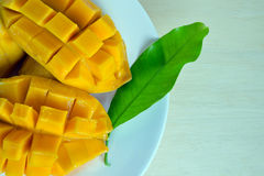 Sliced ripe yellow mango with leaf Stock Photography