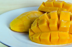 Sliced ripe yellow mango on the plate Stock Photo