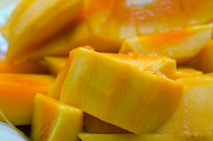 Sliced ripe yellow mango on the plates Stock Image